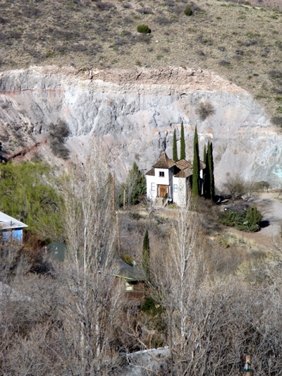 "The former ""Mexican"" church, now a private residence. The United Verde Extension mine tailings form the backdrop."