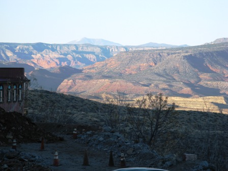 Sycamore Canyon, to the east, across a pitted Jerome parking place.