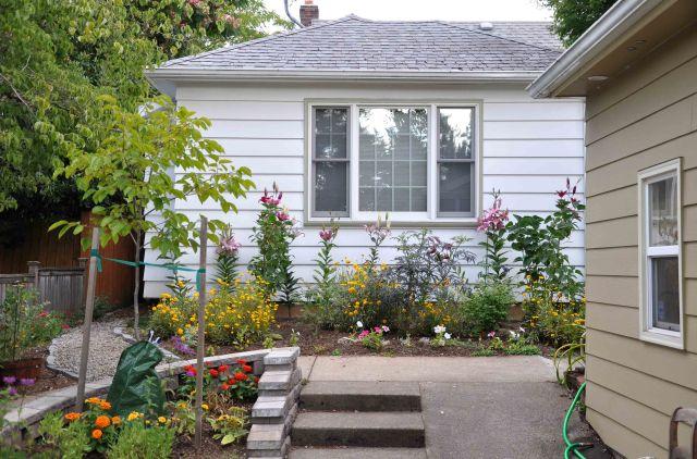 July flowers back driveway